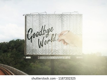 A large billboard with a hand writing the word: Goodbye World.