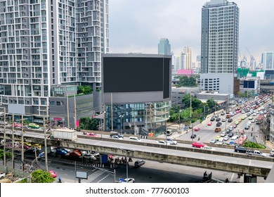 Large billboard on building with crowded traffic in bangkok city