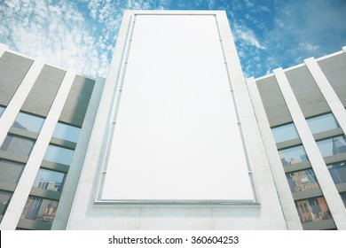 Large billboard on the wall of a building on a sky background