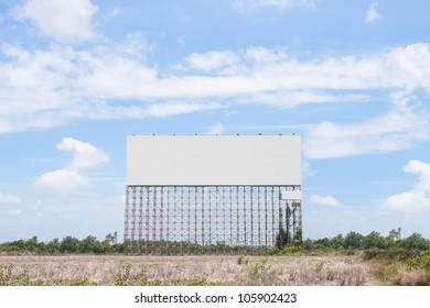 Large billboards. Located along the road.