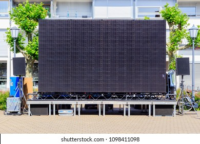 Large black Open-Air Public Screen for Sport,  Event,  Music,  Promotion  Public Viewing in German city center, frame text place