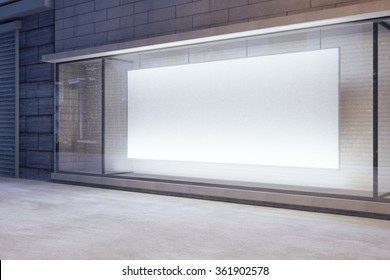 Large blank banner in a shop window at night, mock up 3D Render