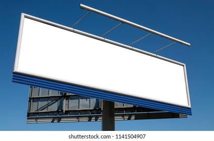 Large blank billboard against blue sky