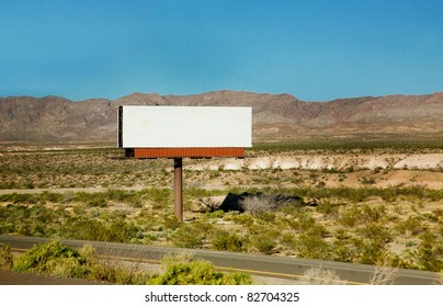 A large blank billboard by a road in the desert - ready for your own message!