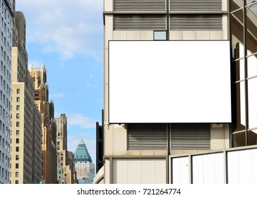 Large blank billboard in the city. Clipping paths included for ad space and its reflection