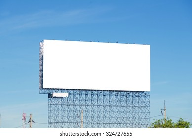 large blank billboard on building in city view background.