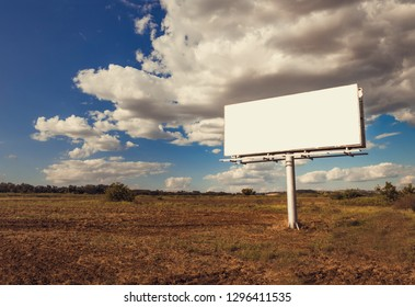 Large blank billboard on a rural location, banner with room to a