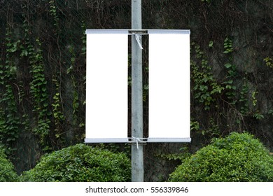 Large blank billboard on a street wall,  banners with room to add your own text