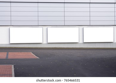 Large blank billboard on a supermarket wall, banners with room to add your own text
