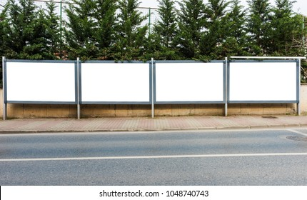 Large blank billboards for outdoor advertising.