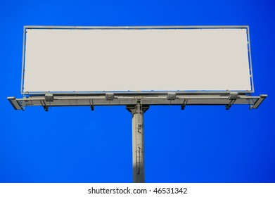 Large blank commercial billboard against cloudy sky