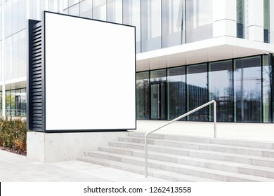 Large blank outdoor billboard template with white copy space to add multiple company names and logos with modern office building in background