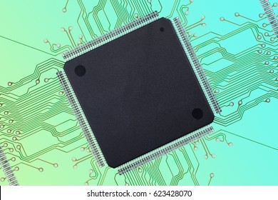 Large, blank Thin Quad Flat Package  TQFP  Integrated Circuit  IC chip  with Printed Circuit Board  PCB  Connections on a nice colorful teal and green background.