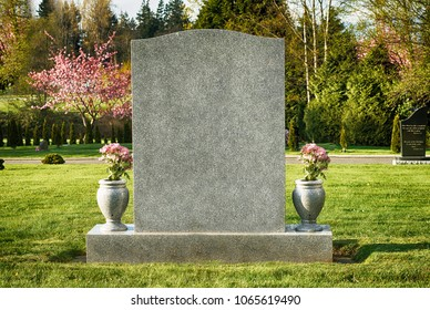 Large blank tombstone in cemetery