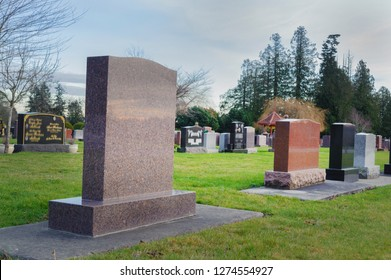 Large blank tombstones in cemetery