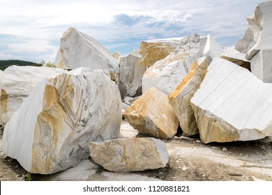 large blocks of marble on a blue sky background, marble quarry