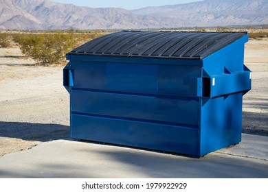 A large blue commercial dumpster for trash or recycling.
