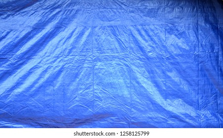 Large Blue Plastic Tarp Background With Wrinkles & Shadows