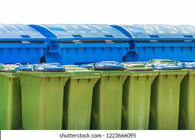 Large blue and small green waste containers isolated on a white background