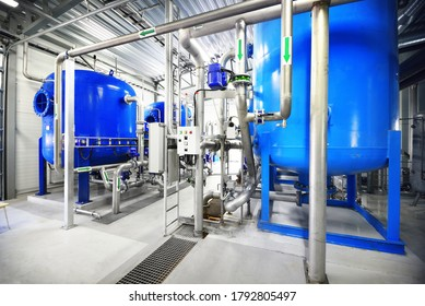 Large blue tanks in a industrial city water treatment boiler room. Wide angle perspective. Special equipment, technology, drinking water supply, chemical modifications, environmental conservation