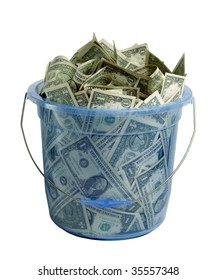 Large blue transparent plastic bucket filled with dollar bills on white background
