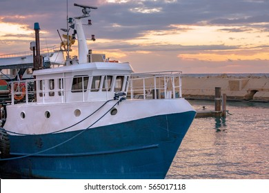 Large Blue & White Fishing Boat docked in port - Sunset - Jaffa Port - Near Tel Aviv, Israel