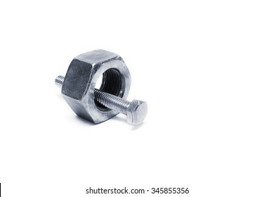 Large bolt and small nut on white background, One size does Not fit all concept