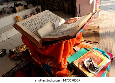 A large book of Hindu scriptures at the altar in the temple. India, Udaipur, January 13, 2019.