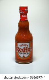 Large bottle of Frank's redhot wing sauce product photo on an isolated white background. - Illustrative Editorial