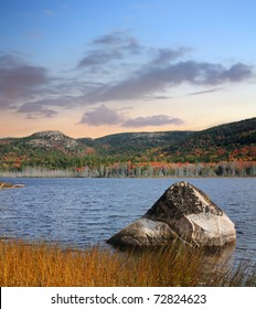 A Large Boulder Sits In Seal Cove Pond, A Beautiful Autumn Evening On Mount Desert Island, Acadia National Park, Maine, USA