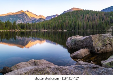 Large boulders in Bear Lake which reflects the Mountains which surround it, Rocky Mountain National Park, CO, USA
