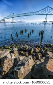Large boulders lead into the image of the landmark bridge in Astoria, Oregon.