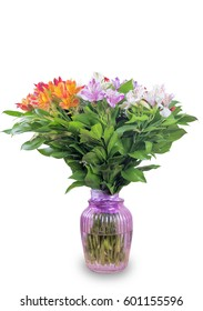 A large bouquet of Alstroemeria in a vase on white background