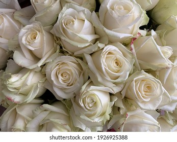 A large bouquet of blossoming flowers, close-up. Background texture: buds of white roses in a vase. Blooming spring flowers for a gift.