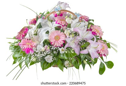 a large bouquet of flowers in a basket on a white background