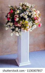 Large bouquet made of different kind of artificial flowers on a stand