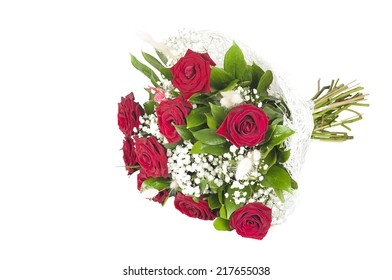 a large bouquet of red roses with greens