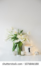Large bouquet of white spring flowers in a vase, daffodils, tuli