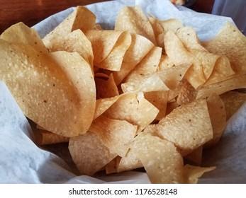 large bowl of corn tortilla chips in basket