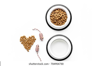 large bowl of pet - cat food with heart print on white background top view mockup