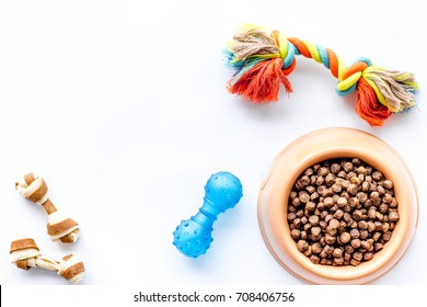 large bowl of pet - dog food with toys on white background top view mockup