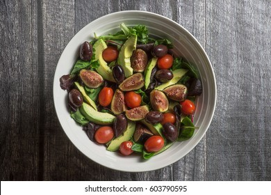 Large bowl of salad on wood