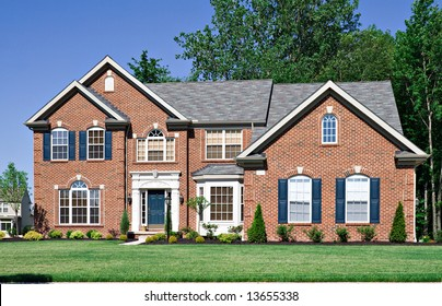 A large brick house in the suburbs in Ohio USA.