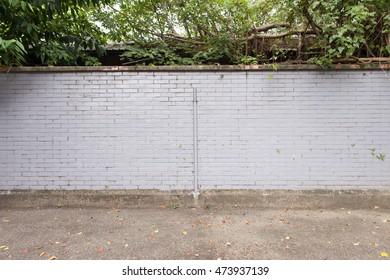 Large brick wall on a street wall, banners with room to add your own text