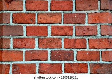 Large brickwork with stamps and gray cement texture.