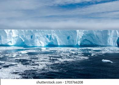 Large bright blue iceburg floating in Antarctica.