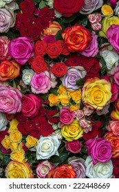 Large bright bouquet of multicolored roses