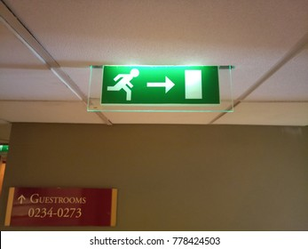 Large bright green fire exit lights