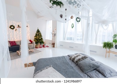 large bright spacious stylish living room with a pendant bed decorated with a Christmas tree