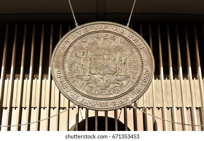 The large bronze medallion that hangs from the state legislature building Honolulu, Hawaii, USA: The Hawaii State Seal on the Hawaii Legislature Building in downtown Honolulu.